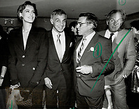 1986 FILE PHOTO - ARCHIVES -<br /> <br /> Chanel super-model Ines de la Fressange, wearing mini-bottles of Coco as earrings, and Michel Pietrini, president of Chanel International, join the merry throng of 1,000 guests who jammed celebration.<br /> <br /> 1986<br /> <br /> PHOTO :  Erin Comb - Toronto Star Archives - AQP
