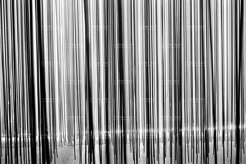 """Switzerland. Vaud canton. Yverdon. Arteplage, Expo 02. """"Signal Pain"""". Thousands of threads hang from the roof, like so many nerve-endings. As you penetrate into the tangle of threads, you gradually come to grips with pain without actually having to experience it yourself. National exhibition. © 2002 Didier Ruef."""