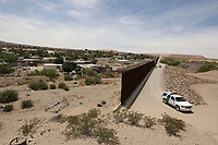 Sunland Park, NM - NEWS:   Ride along with Customs and Border Protection agents, Sunland Park, NM, Monday, April 29, 2019.<br /> <br /> <br /> PICTURED:  The border fence separating Mexico and the United States - Sunland Park, New Mexico.  The Mexican neighborhood of Rancho Anapra is on the left.  The border fence abruptly ends.<br /> <br /> (Angel Chevrestt, 646.314.3206)