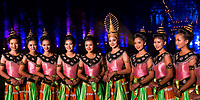 Beautiful Thai dancers in their traditional dresses during the Loy Krathong festival at Wat Mahathat Temple in the Sukhothai Historical Park, Thailand
