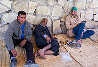 Morocco.  Men Relaxing over Tea, Had Draa Market, Essaouira Province.