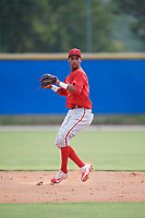 Philadelphia Phillies Jonathan Guzman (8) throws to first base during an Instructional League game against the Toronto Blue Jays on October 7, 2017 at the Englebert Complex in Dunedin, Florida.  (Mike Janes/Four Seam Images)