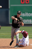 Evan Busby #11 of the Cal Poly Mustangs throws to first base against the Loyola Marymount Lions at Page Stadium on February 25, 2012 in Los Angeles,California. Cal Poly defeated LMU 12-5.(Larry Goren/Four Seam Images)