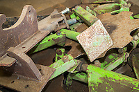 Old plough parts in a farm workshop