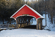 Flume Covered Bridge in Franconia Notch State Park of Lincoln, New Hampshire USA during the winter months. This bridge crosses the Pemigewasset River.