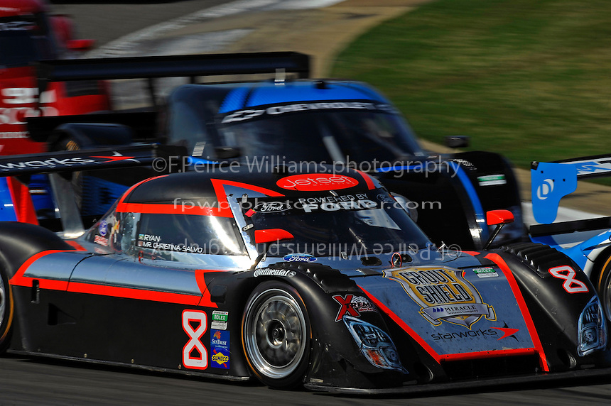 #8 Starworks Motorsports Ford/Riley of Mike Forest &  Ryan Dalziel in a pack through turn 4.