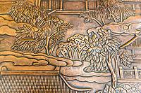 Nanjing, Jiangsu, China.  Copper Wall Engraving, Usnisa Palace, Niushou Mountain.