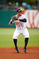Montgomery Biscuits shortstop Daniel Robertson (4) throws to first during a game against the Jackson Generals on April 29, 2015 at Riverwalk Stadium in Montgomery, Alabama.  Jackson defeated Montgomery 4-3.  (Mike Janes/Four Seam Images)