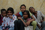 Sheikh Alamgir and his friends (with whom he lives)at the Sealdah railway premises. Alamgir is staying here for last 6 years from the time he ran away from his home due to domestic violence and poverty. As per his version his father was a drunkard and used to beat his mother for no reason. His father even could not earn enough money to buy food for their big family. Due to this traumatic situation he ran away from house at the age of seven. Ever since, the Sealdah railway station in Kolkata has been his home. As far as company is concerned, he had not much reason to miss his family. There are around 500 children, from 5 to 16 years, who live in the premises of Kolkata's second largest train terminus. Most of them addicted to Brown Sugar and sniffing industrial adhesive Dendrite. They say they don't feel hungry if they take the drugs. Their presence is conspicuous, even in a place that registers an average footfall of 1.4 million on weekdays. Their activities cover a wide range, from begging, to pulling handcarts, to petty theft, to selling odds and ends on the platform or on trains. The money, earned or ill-gotten as the case may be, is spent in procuring heroin, brown sugar, cocaine, and tubes of Dendrite. Calcutta, West Bengal, India. Arindam Mukherjee