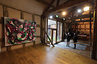 Pictured: Guardian Art correspondent Mark Brown (R) and Anthony Plant (L) of the Sidney Nolan Trust, in the exhibition area Friday 02 December 2016<br /> The Sidney Nolan Trust, Rodd, Herefordshire, England, UK
