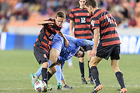 Houston, TX -  Friday, December 9, 2016: Jared Gilbey (15) of the Stanford Cardinal and Tucker Hume (36) of the North Carolina Tar Heels battle for control of the ball  at the  NCAA Men's Soccer Semifinals at BBVA Compass Stadium.