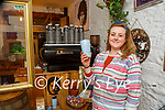 Ellen Buckley with the reusable coffee cup they have on sale in the Black Sheep Hostel