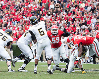 The Georgia Bulldogs beat the App State Mountaineers 45-6 in their homecoming game.  After a close first half, UGA scored 31 unanswered points in the second half.  Appalachian State Mountaineers quarterback Kameron Bryant (5) passes the ball