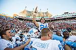 North Carolina team hoists kicker Nick Weiler on their shoulders after Weiler kicked the game winning 54 yard field goal against Florida State as time ran out in an NCAA college football game in Tallahassee, Fla., Saturday, Oct. 1, 2016. North Carolina defeated Florida State 37-35 on a field goal. (AP Photo/Mark Wallheiser)