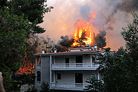 Pictured: Flames near a house in Thrakomakedones near Athens, Greece. Saturday 07 August 2021<br /> Re: Forest fire in Varibobi, in the areas north of of Athens, Greece.