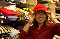 June 16 , 2002, Montreal, Quebec, Canada<br /> <br /> A Japanese tourist look a souvenir items in a Old Montreal shop, June 16 , 2002.<br /> <br /> Model released for all usages.<br /> <br /> Mandatory Credit: Photo by Pierre Roussel- Images Distribution. (©) Copyright 2002 by Pierre Roussel <br /> <br /> NOTE Nikon D-1 jpeg opened with Qimage icc profile, saved in Adobe 1998 RGB. Original size - uncropped TIFF file available on request.
