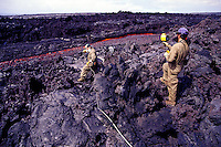 Two USGS geologists take and record lava samples at Volcanoes National Park on the Big Island of Hawaii.