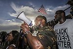 BATON ROUGE, LA - JULY 09:  Demonstrators gather after marching at the Louisiana Capitol to protest the shooting of Alton Sterling on July 9, 2016 in Baton Rouge, Louisiana. Alton Sterling was shot by a police officer in front of the Triple S Food Mart in Baton Rouge on July 5th, leading the Department of Justice to open a civil rights investigation. (Photo by Mark Wallheiser/Getty Images)