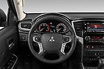 Car pictures of steering wheel view of a 2020 Mitsubishi L200 Intense-Edition-One 4 Door Pick-up Steering Wheel