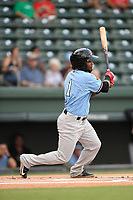 Shortstop Yonny Hernandez (1) of the Hickory Crawdads follows through on a swing during a game against the Greenville Drive on Monday, August 20, 2018, at Fluor Field at the West End in Greenville, South Carolina. Hickory won, 11-2. (Tom Priddy/Four Seam Images)