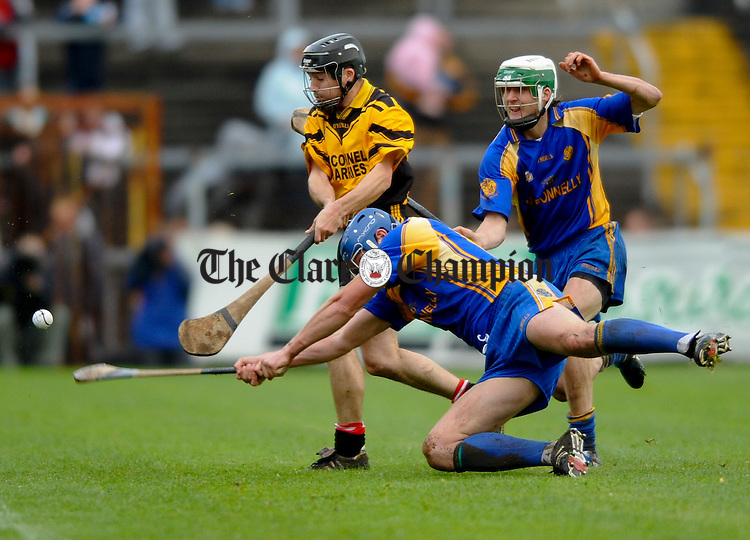 Newmarket's James Mc Inernay and Enda Barrett combine forces against Clonlara's Diarmuid Conway during their senior county final at Cusack Park. Photograph by John Kelly.