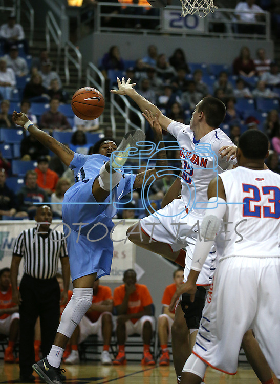 Gorman's Zach Collins blocks the shot of Canyon Springs' Shaqille Carr during the Division I championship game in the NIAA basketball state tournament at Lawlor Events Center, in Reno, Nev., on Friday, Feb. 28, 2014. (Cathleen Allison/Las Vegas Review-Journal)