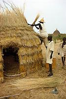 Men making a thatch hut in Kanem, Chad, Africa..