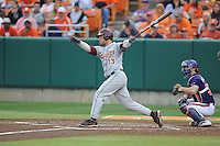 Florida State Seminoles catcher Danny De La Calle #13 swings at a pitch during a game against the Clemson Tigers at Doug Kingsmore Stadium on March 22, 2014 in Clemson, South Carolina. The Seminoles defeated the Tigers 4-3. (Tony Farlow/Four Seam Images)