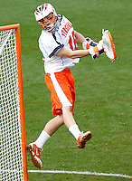Virginia Cavaliers goalie Rob Fortunato (18) defends the goal during the game against the Johns Hopkins in Charlottesville, VA. Johns Hopkins defeated Virginia 11-10 in overtime. Photo/Andrew Shurtleff