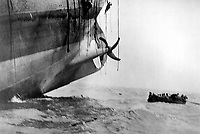 Last minute escape from vessel torpedoed by German sub.  The vessel has already sunk its bow into the waves, and her stern is slowly lifting out of the water.  Men can be seen sliding down ropes as the last boat is pulling away.  Ca.  1917. Underwood & Underwood. (Army)<br /> EXACT DATE SHOT UNKNOWN<br /> NARA FILE #:  111-SC-16568<br /> WAR & CONFLICT BOOK #:  694
