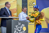 Fernando Gaviria (COL/Quick Step Floors) wins the sprint of the first stage and takes the Yellow Jersey.  Felicitated on podium by Eddy Merckx and Prince Albert of Monaco.<br /> <br /> Stage 1: Noirmoutier-en-l'Île > Fontenay-le-Comte (189km)<br /> <br /> Le Grand Départ 2018<br /> 105th Tour de France 2018<br /> ©kramon