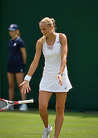 25-06-13, England, London,  AELTC, Wimbledon, Tennis, Wimbledon 2013, Day two, Arantxa Rus (NED) throws her racket to the ground in anger<br /> <br /> <br /> <br /> Photo: Henk Koster