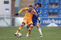 Jordan Bowery of Mansfield Town and Miles Welch-Hayes of Colchester United during Colchester United vs Mansfield Town, Sky Bet EFL League 2 Football at the JobServe Community Stadium on 14th February 2021