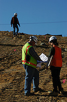 Faten Khabib and George Copenhaver of Helenschmidt Geotechnical Inc stand on the incline of the landslide on Mount Soledad, Friday January 18, 2008.