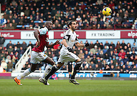 Pictured L-R: Guy Demel of West Ham chasing Chico Flores of Swansea. 01 February 2014<br />