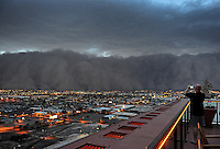 Apr. 26, 2011; Phoenix, AZ, USA; A man takes a picture as a dust storm converges on downtown Phoenix the home to the 2011 MLB All Star Game at Chase Field. Mandatory Credit: Mark J. Rebilas-