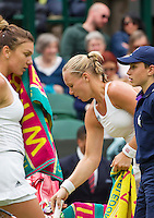London, England, 2 July, 2016, Tennis, Wimbledon, Kiki Bertens (NED) during changeover, left Simona Halep (ROU)<br /> Photo: Henk Koster/tennisimages.com