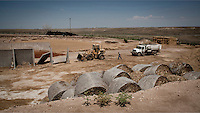 Construction of a cattle pen at a feedyard in Mead, Kansas. A feedyard is part of the factory farming process where animals are fattened up prior to slaughter. They are mostly fed on corn or corn dervived products gaining between 2.5 and 4.5 pounds per day. 25% of all American beef is produced in Kansas.