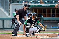Caballeros de Charlotte catcher Seby Zavala (5) sets a target as home plate umpire Adam Beck looks on during the game against the Buffalo Bisons at BB&T BallPark on July 23, 2019 in Charlotte, North Carolina. The Bisons defeated the Caballeros 8-1. (Brian Westerholt/Four Seam Images)