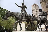 """Spain. Province of Madrid. Madrid. Plaza (Place) Espana. Statues of Don Quijote de la Mancha and his companion Sancho Panza. """"The Ingenious Hidalgo Don Quixote of La Mancha"""" is an early novel written by Spanish author Miguel de Cervantes Saavedra. The protagonist, Alonso Quixano, is a landowner who has read so many stories of chivalry that he descends into fantasy and becomes convinced he is a knight errant. Together with his companion Sancho Panza, the self-styled Don Quixote de la Mancha sets out in search of adventures. Horse and donkey. Downtown. Town center.  © 2007  Didier Ruef"""