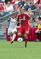 29 June 2013: Toronto FC midfielder Ryan Richter #33 and Real Salt Lake forward Joao Plata #8 in action during an MLS game between Real Salt Lake and Toronto FC at BMO Field in Toronto, Ontario Canada.