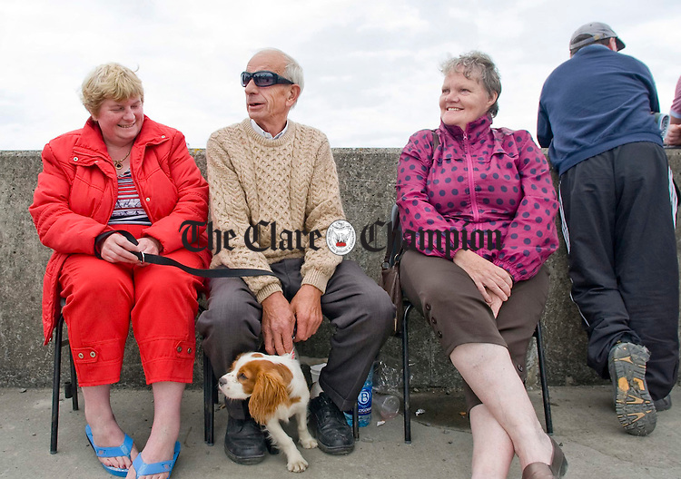 Ann O' Driscoll, Martin Whelan and Mary Browne relaxing behind the scenes at the All Ireland currach racing championships in Doonbeg. Photograph by Declan Monaghan