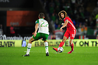 Conor Hourihane of Republic of Ireland vies for possession with Ethan Ampadu of Wales during the UEFA Nations League B match between Wales and Ireland at Cardiff City Stadium in Cardiff, Wales, UK.September 6, 2018