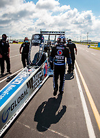 Jul 10, 2020; Clermont, Indiana, USA; NHRA top fuel driver Antron Brown walks to his dragster during testing for the Lucas Oil Nationals at Lucas Oil Raceway. This will be the first race back for NHRA since the COVID-19 pandemic. Mandatory Credit: Mark J. Rebilas-USA TODAY Sports