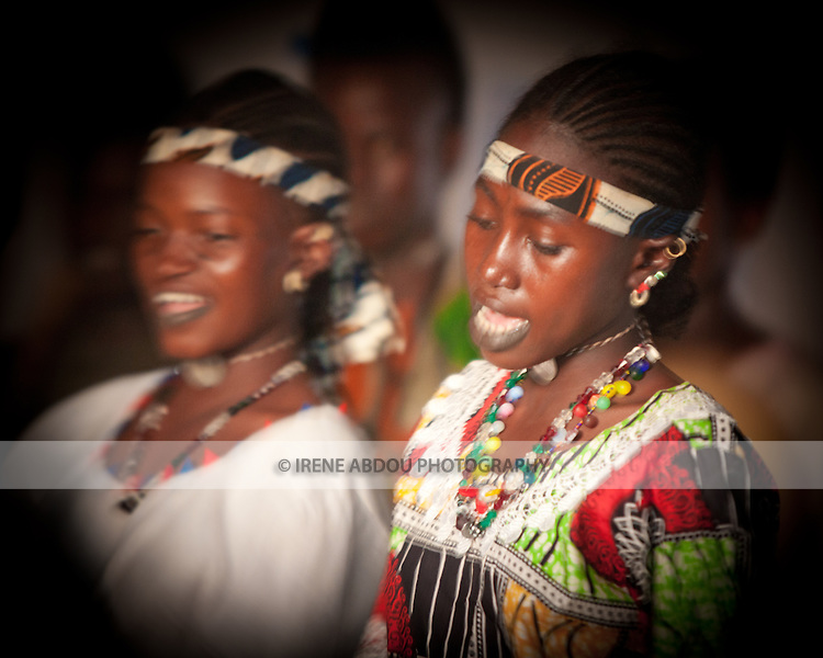 """In the town of Djibo in northern Burkina Faso, young """"doohoobe"""" (people who sing """"doohaali"""") dance in traditional fashion. The women clap their hands and sing as the men """"dooho,"""" or sing a distinct, deep rhythmic chant.  """"Doohaali"""" is a distinct form of music practiced only by the Fulani in Djelgooji, a particular area of Burkina Faso. The young women in this image are the winners of a regional music and arts competition, going on to perform at Burkina Faso's 2010 """"Semaine Nationale de la Culture"""" (SNC) in Bobo-Dioulasso."""