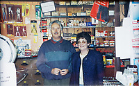 Pictured: Former store owners John and Liz Lloyd. <br /> Re: Shop owner Thomas Lewis Jones has made a Christmas advert starring Arthur Lewis Jones, his two-year-old son costing only £100.<br /> Hafod Hardware in Rhayader, Powys, has been making festive adverts for several years.<br /> This year's advert sees Arthur setting up the shop along with members of his family.