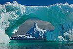 Icebergs, Antarctica<br /> <br /> I can never get enough of photographing icebergs. Their gradients of icy blue are mesmerizing, as are their endless shapes. I love the way the green arch surrounds the distant blue icebergs, and how some of the blue-green ice is showing just below the water's surface.