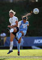 SAN DIEGO, CA - DECEMBER 02, 2012:  Ranee Premji (10) of the University of North Carolina clashes in the air against Christine Nairn (10) of Penn State University during the NCAA 2012 women's college championship match, at Torero Stadium, in San Diego, CA, on Sunday, December 02 2012. Carolina won 4-1.