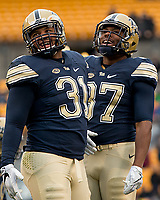Jaymar Parrish and Qadree Ollison celebrate a touchdown. The Pitt Panthers defeated the Syracuse Orange 76-61 at Heinz Field in Pittsburgh, Pennsylvania on November 26, 2016.