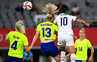 TOKYO, JAPAN - JULY 20: Carli Lloyd #10 of the United States heads a ball during a game between Sweden and USWNT at Tokyo Stadium on July 20, 2021 in Tokyo, Japan.